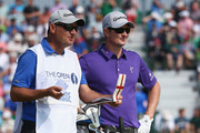 Justin Rose of England waits with his caddie Mark Fulcher on the fourth tee during the second round of The 143rd Open Championship at Royal Liverpool on July 18, 2014 in Hoylake, England.