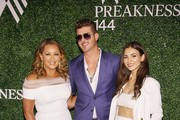 (L-R) Vanessa Williams, Robin Thicke, and Victoria Justice at the 144th Preakness Stakes at Pimlico Race Track on May 18, 2019 in Baltimore, Maryland.