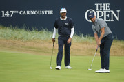 Bubba Watson of the United States (L) looks on as Webb Simpson of the United States putts during previews to the 147th Open Championship at Carnoustie Golf Club on July 17, 2018 in Carnoustie, Scotland.