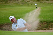 Lee Westwood of England plays a shot out of a bunker during a practice round prior to the 148th Open Championship held on the Dunluce Links at Royal Portrush Golf Club on July 16, 2019 in Portrush, United Kingdom.
