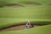 Justin Thomas of the United States plays a shot from a bunker during a practice round prior to the 148th Open Championship held on the Dunluce Links at Royal Portrush Golf Club on July 16, 2019 in Portrush, United Kingdom.