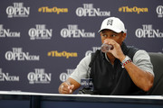 Tiger Woods of the United States drinks water as he speaks to the media during a press conference during a practice round prior to the 148th Open Championship held on the Dunluce Links at Royal Portrush Golf Club on July 16, 2019 in Portrush, United Kingdom.