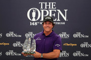 Phil Mickelson of The United States receives an award for spending the last 25 years in the top 50 best ranked players in the World official ranking during a practice round prior to the 148th Open Championship held on the Dunluce Links at Royal Portrush Golf Club on July 16, 2019 in Portrush, United Kingdom.