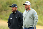 Shane Lowry of Ireland and Graeme McDowell of Northern Ireland look on at the 18th hole during a practice round prior to the 148th Open Championship held on the Dunluce Links at Royal Portrush Golf Club on July 17, 2019 in Portrush, United Kingdom.