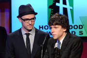 Actors Justin Timberlake (L) and Jesse Eisenberg speak onstage during the 14th annual Hollywood Awards Gala at The Beverly Hilton Hotel on October 25, 2010 in Beverly Hills, California.