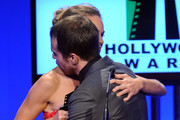 Actress Hilary Swank presents the Hollywood Supporting Actor Award to actor Sam Rockwell onstage during the 14th annual Hollywood Awards Gala at The Beverly Hilton Hotel on October 25, 2010 in Beverly Hills, California.