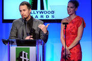 Actress Hilary Swank (R) presents the Hollywood Supporting Actor Award to actor Sam Rockwell onstage during the 14th annual Hollywood Awards Gala at The Beverly Hilton Hotel on October 25, 2010 in Beverly Hills, California.