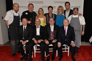 Back Row (L to R) Chef Sam Tucker, Chef Bob Waggoner, Sheryl Crow, Gary Allan, Laura Heatherly (CEO, T.J. Martell Foundation), Luke Bryan, Chef Sean Brock.Front Row (L to R) Co-chair Bill Hearn (President, EMI Christian Group), Co-chair Tom Black, Co-chair John Esposito (President & CEO, Warner Music Nashville), Founder Billy Ray Hearn (Founder, EMI Christian Music Group). attend the 14th annual T.J. Martell Foundation Nashville Best Cellars dinner at the Bridge Building on April 29, 2013 in Nashville, Tennessee.