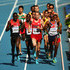 Galen Rupp Isiah Kiplangat Koech Photos - Isiah Kiplangat Koech of Kenya, Galen Rupp of the United States and Mo Farah of Great Britain compete during the Men's 5000 metres heats during Day Four of the 14th IAAF World Athletics Championships Moscow 2013 at Luzhniki Stadium on August 13, 2013 in Moscow, Russia. - IAAF World Athletics Championships Moscow: Day 4