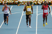 (L-R) Adam Gemili of Great Britain, Usain Bolt of Jamaica and Curtis Mitchell of the United States compete in the Men's 200 metres final during Day Eight of the 14th IAAF World Athletics Championships Moscow 2013 at Luzhniki Stadium on August 17, 2013 in Moscow, Russia.