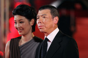Director Feng Xiaogang and his wife Xu Fan arrive at the opening ceremony of the 14th Shanghai International Film Festival on June 11, 2011 in Shanghai, China.