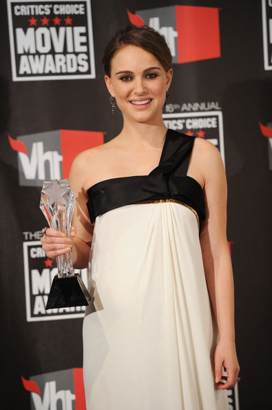 "Actress Natalie Portman poses with the Best Actress award for ""Black Swan"" in the press room during the 16th annual Critics' Choice Movie Awards at the Hollywood Palladium on January 14, 2011 in Los Angeles, California."