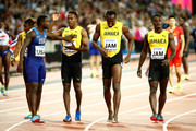 Usain Bolt of Jamaica is attended to by teammmates Tyquendo Tracey, Julian Forte and Michael Campbell and Justin Gatlin of the United States after falling in the Men's 4x100 Relay final during day nine of the 16th IAAF World Athletics Championships London 2017 at The London Stadium on August 12, 2017 in London, United Kingdom.