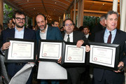 (L-R) Honorees Rodrigo Teixeira, Luca Guadagnino, Michael Barker and Tom Bernard pose with awards during 18th Annual AFI Awards at Four Seasons Hotel Los Angeles at Beverly Hills on January 5, 2018 in Los Angeles, California.