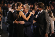 (L-R) Director David O. Russell and actors Jennifer Lawrence, Robert De Niro and Bradley Cooper attend the 18th Annual Critics' Choice Movie Awards held at Barker Hangar on January 10, 2013 in Santa Monica, California.
