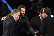(L-R) Actors Robert De Niro, Bradley Cooper and writer/director David O. Russell onstage at the 18th Annual Critics' Choice Movie Awards held at Barker Hangar on January 10, 2013 in Santa Monica, California.