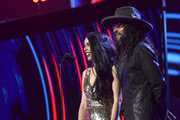 Beatriz Luengo and Draco Rosa speak onstage during the 19th annual Latin GRAMMY Awards at MGM Grand Garden Arena on November 15, 2018 in Las Vegas, Nevada.