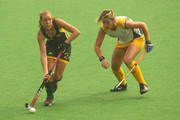 Fiona Boyce of Australia and Tarryn Bright of South Africa contest the ball during the women's pool A match between Australia and South Africa at Major Dhyan Chand National Stadium during day five of the Delhi 2010 Commonwealth Games on October 8, 2010 in Delhi, India.