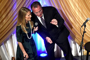 Tracie Hamilton of J/P Haitian Relief Organization (L) and Vice President, General Manager at Grand Ole Opry Pete Fisher speak onstage during the 1st Annual Nashville Shines for Haiti concert benefiting J/P Haitian Relief Organization - Day 1 on April 26, 2016 in Nashville, Tennessee.