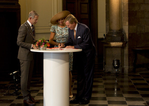 King Willem-Alexander of The Netherlands signs the guest book in the city hall, watched by Queen Maxima of The Netherlands as he attends celebrations marking the 200th anniversary of the kingdom of The Netherlands on August 30, 2014 in Maastricht, The Netherlands.