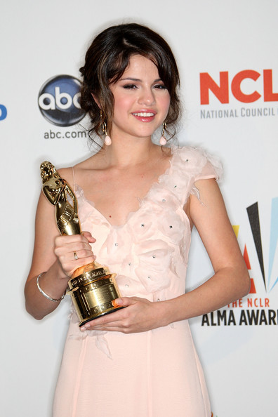 Selena Gomez Actress Selena Gomez poses in the press room after winning the Year in Televison Comedy Actress award for