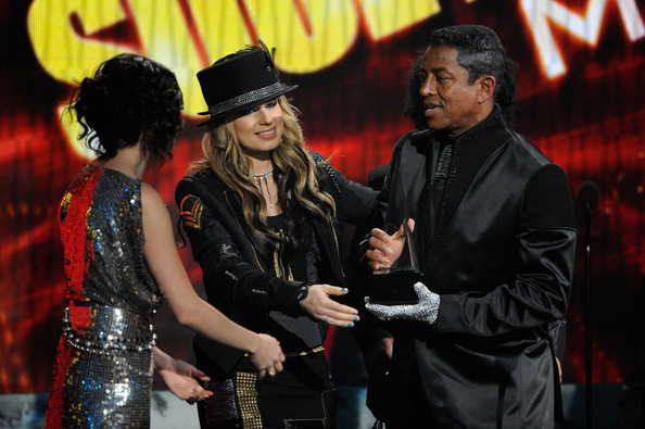 Selena Gomez Actress Selena Gomez (L) and singer Orianthi present singer Jermaine Jackson Winner of Soul/R&B - Favorite Male Artist Award for Michael Jackson onstage at the 2009 American Music Awards at Nokia Theatre L.A. Live on November 22, 2009 in Los Angeles, California.
