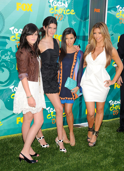 Kendall Jenner TV personalities Kylie Jenner, Kendall Jenner, Kourtney Kardashian and Kourtney Kardashian arrive at the 2009 Teen Choice Awards held at Gibson Amphitheatre on August 9, 2009 in Universal City, California.