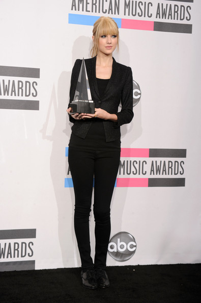 Musician Taylor Swift, winner of the Country Music - Favorite Female Artist award, poses in the press room during the 2010 American Music Awards held at Nokia Theatre L.A. Live on November 21, 2010 in Los Angeles, California.