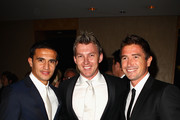 Tim Cahill (L) and Harry Kewell (R) of the Socceroos and Cricketer Brett Lee (C) arrive for the Australian Football Awards at Sofitel Hotel on October 7, 2010 in Sydney, Australia.