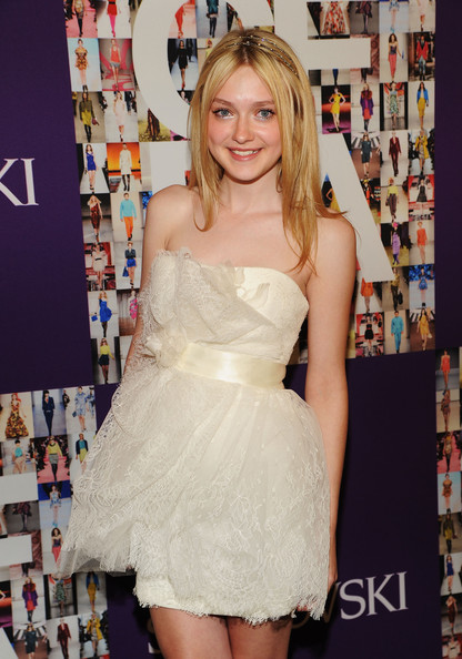 Actress Dakota Fanning poses at the 2010 CFDA Fashion Awards at Alice Tully Hall, Lincoln Center on June 7, 2010 in New York City.