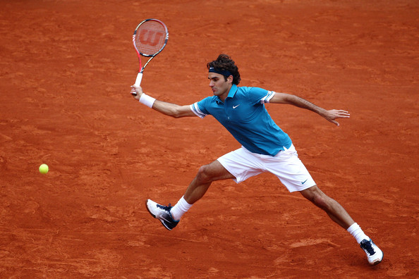 Roger Federer of Switzerland plays a forehand during the men's singles quarter final match between Robin Soderling of Sweden and Roger Federer of Switzerland at the French Open on day ten of the French Open at Roland Garros on June 1, 2010 in Paris, France.