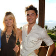 He hangs out with Malin Akerman in paradise.