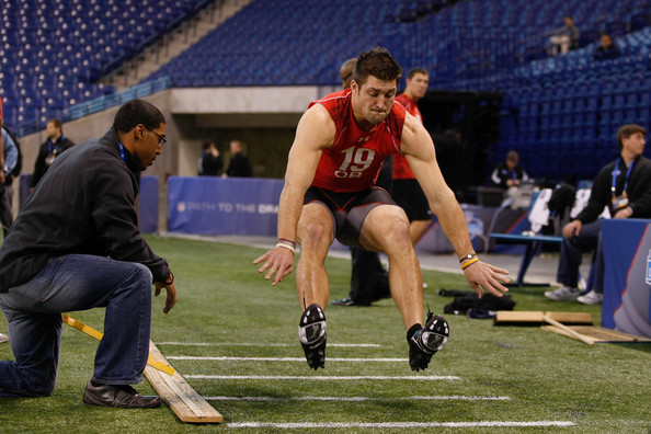 Tim Tebow Quarterback Tim Tebow of Florida performs the long jump during the NFL Scouting Combine presented by Under Armour at Lucas Oil Stadium on February 28, 2010 in Indianapolis, Indiana.
