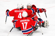 Eskil Hagen #7 of Norway celebrates scoring the game-winning goal with teammates Tommy Rovelstad #4 and Loyd Remi Johansen #17 to defeat Canada 2-1 during the Ice Sledge Hockey Bronze Medal Game on day eight of the 2010 Vancouver Winter Paralympic Games at UBC Thunderbird Arena on March 19, 2010 in Vancouver, Canada.