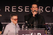 Creative director of Barneys Simon Doonan and actor Cheyenne Jackson speak onstage at the 2010 amfAR New York Inspiration Gala at The New York Public Library on June 3, 2010 in New York, New York.