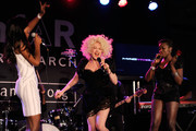Singers Kelly Rowland, Cyndi Lauper, and Estelle perform onstage during the 2010 amfAR New York Inspiration Gala at The New York Public Library on June 3, 2010 in New York, New York.
