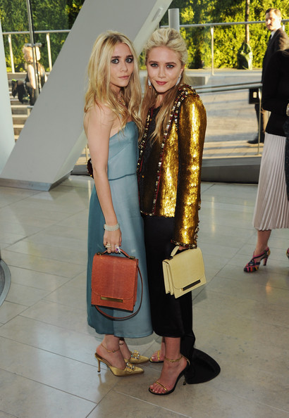 Ashley Olsen (L) and Mary-Kate Olsen attend the 2011 CFDA Fashion Awards at Alice Tully Hall, Lincoln Center on June 6, 2011 in New York City.