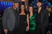 Jay Barker, Sara Evans, Kelli Cashiola and Honoree Dave Haywood of Lady Antebellum attend the 2011 CMT Artists of the year celebration at the Bridgestone Arena on November 29, 2011 in Nashville, Tennessee.