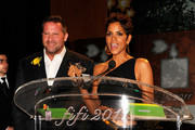 Coty SVP of Global Marketing Steve Mormoris and Halle Berry speak onstage during the 2011 FiFi Awards at The Tent at Lincoln Center on May 25, 2011 in New York City.