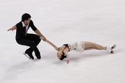 Dan Zhang and Hao Zhang of China perform in the Pairs Short Program during Hilton HHonors Skate America at Citizens Business Bank Arena on October 22, 2011 in Ontario, California.