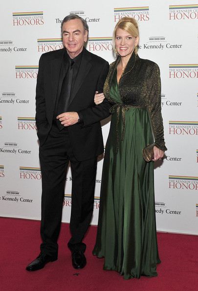(AFP OUT) Neil Diamond and Katie McNeil arrive for the formal Artist's Dinner honoring the recipients of the 2011 Kennedy Center Honors hosted by United States Secretary of State Hillary Rodham Clinton at the U.S. Department of State December 3, 2011 in Washington, DC. President Barack Obama will host the five recipients of the 34th Kennedy Center Honors at a White House reception Sunday before attending the evening gala at the John F. Kennedy Center for the Performing Arts. The 2011 honorees are actress Meryl Streep, singer Neil Diamond, actress Barbara Cook, musician Yo-Yo Ma, and musician Sonny Rollins..