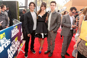 Actors Tyler Posey, Crystal Reed and Dylan O'Brien arrive at the 2011 MTV Movie Awards at Universal Studios' Gibson Amphitheatre on June 5, 2011 in Universal City, California.