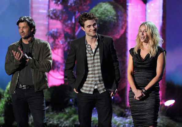 Actors Patrick Dempsey, Robert Pattinson, and Chelsea Handler speak onstage during the 2011 MTV Movie Awards at Universal Studios' Gibson Amphitheatre on June 5, 2011 in Universal City, California.