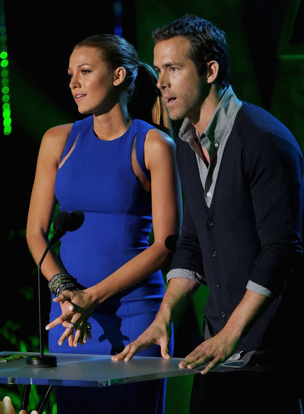 Actors Blake Lively (L) and Ryan Reynolds speak onstage during the 2011 MTV Movie Awards at Universal Studios' Gibson Amphitheatre on June 5, 2011 in Universal City, California.