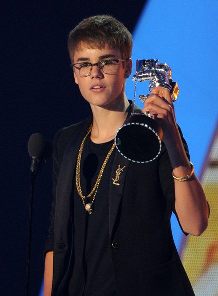 Singer Justin Bieber accepts the Best Male Video award onstage during the 2011 MTV Video Music Awards at Nokia Theatre L.A. LIVE on August 28, 2011 in Los Angeles, California.