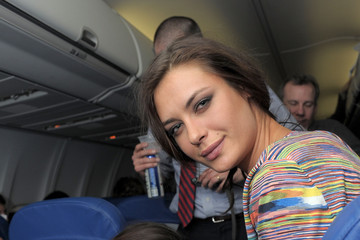 Elena Baguci 2011 SI Swimsuit Models New York To Las Vegas Flight