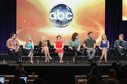 (L-R) Actor Rex Lee, actress Allie Grant, actress Carly Chaikin, actress Jane Levy, creator/executive producer Emily Kapnek, actor Jeremy Sisto, actress Cheryl Hines and actor Alan Tudyk of the television show 'Suburgatory' speak during the Disney ABC Television Group portion of the 2011 Summer Television Critics Association Press Tour held at The Beverly Hilton Hotel on August 8, 2011 in Beverly Hills, California.