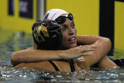 Amanda Beard hugs Rebecca Soni after the women's 200m breaststroke finals during the 2011 AT&T Winter National Championships at the Georgia Tech Aquatic Center on December 3, 2011 in Atlanta, Georgia.