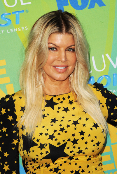 Singer Fergie of The Black Eyed Peas arrives at the 2011 Teen Choice Awards held at the Gibson Amphitheatre on August 7, 2011 in Universal City, California.