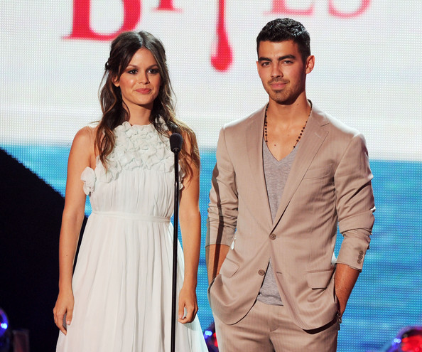Actress Rachel Bilson (L) and musician Joe Jonas speak onstage during the 2011 Teen Choice Awards held at the Gibson Amphitheatre on August 7, 2011 in Universal City, California.
